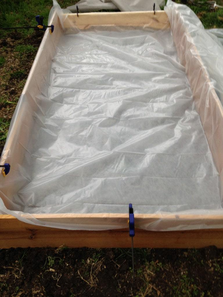 Garden Bed with Plastic Sheet Inside to Create One Layer of Wicking Bed