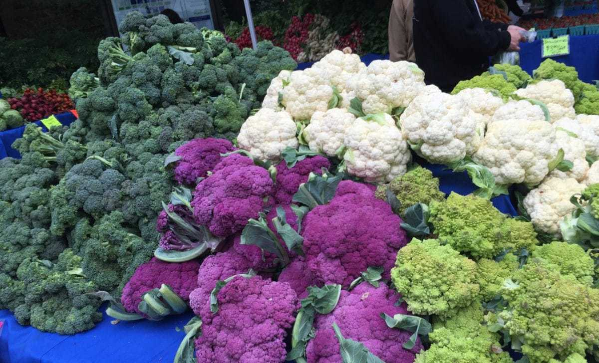 Broccoli and Cauliflower on a Table at the Portland Farmers' Market Guide