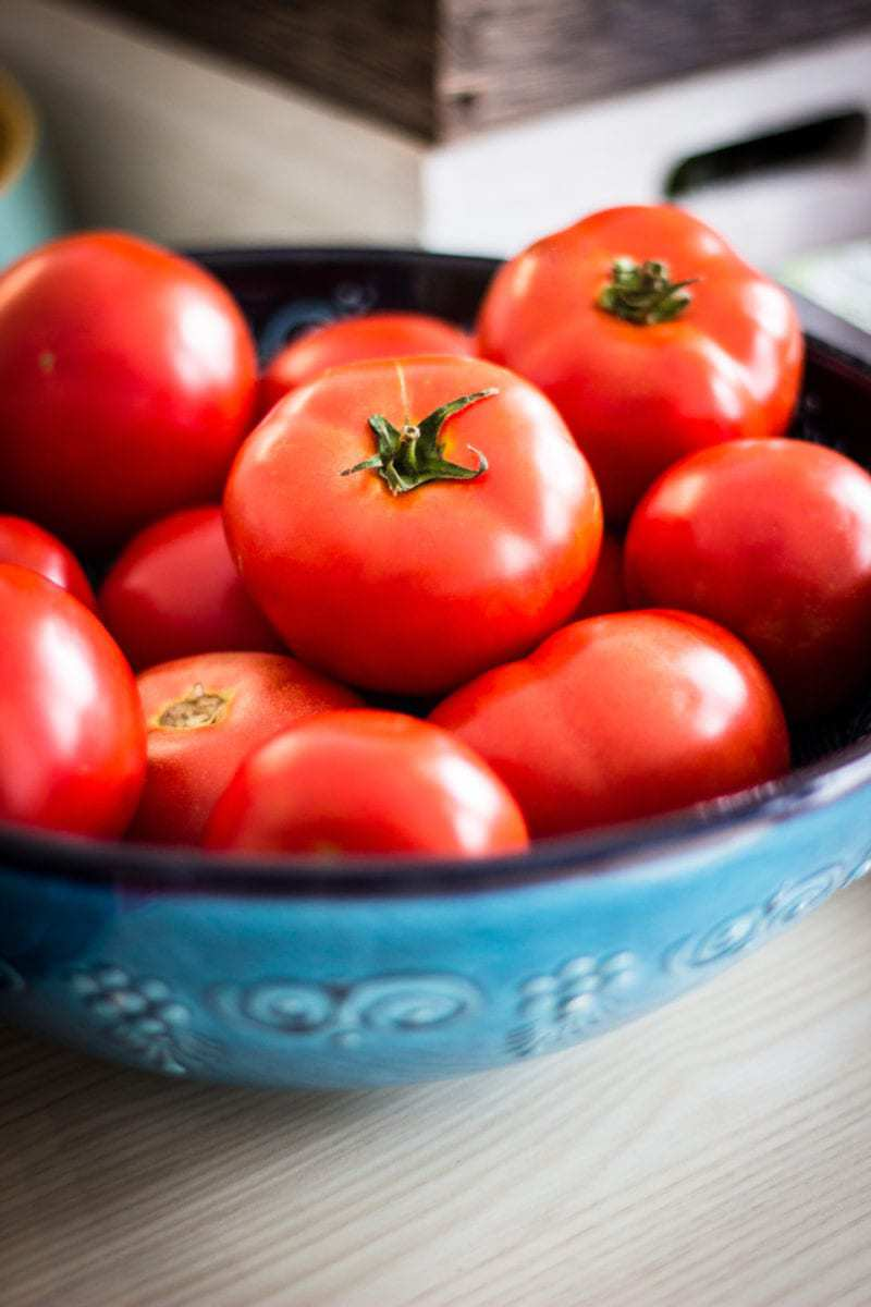 Ripe Tomatoes in Blue Bowls